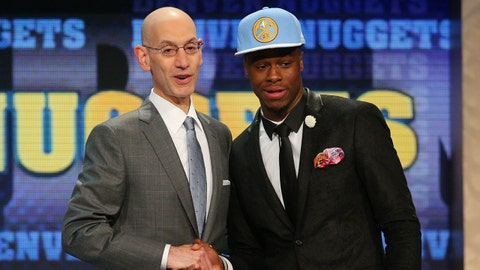 Jun 25, 2015; Brooklyn, NY, USA; Emmanuel Mudiay (China) greets NBA commissioner Adam Silver after being selected as the number seven overall pick to the Denver Nuggets in the first round of the 2015 NBA Draft at Barclays Center. Mandatory Credit: Brad Penner-USA TODAY Sports