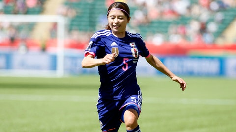 Jun 27, 2015; Edmonton, Alberta, CAN; Japan defender Aya Sameshima (5) dribbles against Australia during the second half in the quarterfinals of the FIFA 2015 Women's World Cup at Commonwealth Stadium. Mandatory Credit: Erich Schlegel-USA TODAY Sports