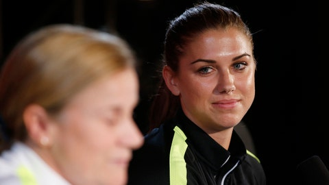 Jun 29, 2015; Montreal, Quebec, CAN; United States forward Alex Morgan (right) listens to head coach Jill Ellis during a press conference before a training session for the Women's World Cup at Olympic Stadium. Mandatory Credit: Michael Chow-USA TODAY Sports