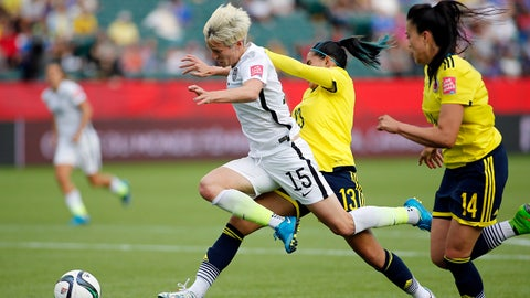 Jun 22, 2015; Edmonton, Alberta, CAN; United States midfielder Megan Rapinoe (15) is fouled by Colombia defender Angela Clavijo (13 in the box during the second half round of sixteen in the FIFA 2015 women's World Cup soccer tournament at Commonwealth Stadium. Mandatory Credit: Erich Schlegel-USA TODAY Sports