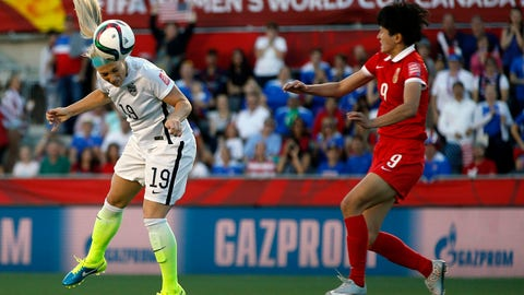Jun 26, 2015; Ottawa, Ontario, CAN; United States defender Julie Johnston (19) heads the ball against China defender Wang Shanshan (9) in the quarterfinals of the FIFA 2015 Women's World Cup at Lansdowne Stadium. Mandatory Credit: Michael Chow-USA TODAY Sports
