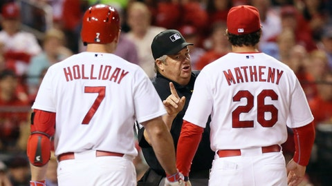 St. Louis Cardinals manager Mike Matheny and outfielder Matt Holliday argue with home plate umpire Joe West after Holliday was called out on strikes in the seventh inning against the Milwaukee Brewers during a baseball game Tuesday, June 2, 2015, in St. Louis. Both Cardinals were ejected. The Cardinals won 1-0. (Chris Lee/St. Louis Post-Dispatch via AP)