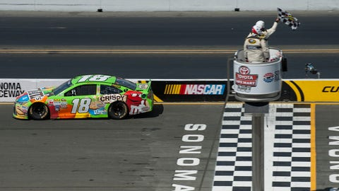 Jun 28, 2015; Sonoma, CA, USA; Sprint Cup Series driver Kyle Busch (18) crosses the finish line under the checkered flag during the Toyota/SaveMart 350 at Sonoma Raceway. Mandatory Credit: Ed Szczepanski-USA TODAY Sports
