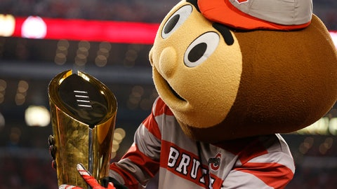 Jan 12, 2015; Arlington, TX, USA; Ohio State Buckeyes mascot Brutus plays with the College Playoff trophy after the game against the Oregon Ducks for the 2015 CFP National Championship Game at AT&T Stadium. Mandatory Credit: Matthew Emmons-USA TODAY Sports
