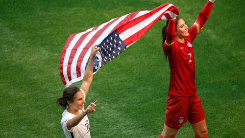 Jul 5, 2015; Vancouver, British Columbia, CAN; United States midfielder Carli Lloyd (10) and United States goalkeeper Hope Solo (1) celebrate with an American flag after defeating Japan in the final of the FIFA 2015 Women's World Cup at BC Place Stadium. United States won 5-2. Mandatory Credit: Erich Schlegel-USA TODAY Sports