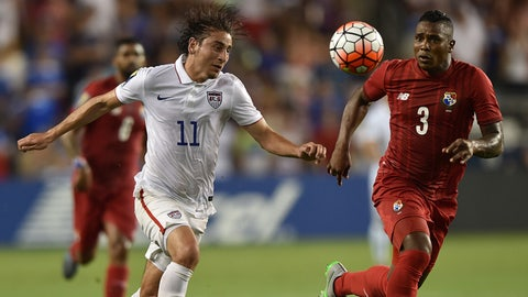 Jul 13, 2015; Kansas City, MO, USA; USA forward Alejandro Bedoya (11) heads the ball in front of Panama defender Harold Cummings (3) in the first half during CONCACAF Gold Cup group play at Sporting Park. Mandatory Credit: Peter G. Aiken-USA TODAY Sports