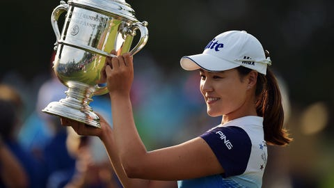 LANCASTER, PA - JULY 12: In Gee Chun of South Korea poses for photographs with the trophy after winning the U.S. Women's Open at Lancaster Country Club on July 12, 2015 in Lancaster, Pennsylvania. Chun went on to win the Open. (Photo by Drew Hallowell/Getty Images)