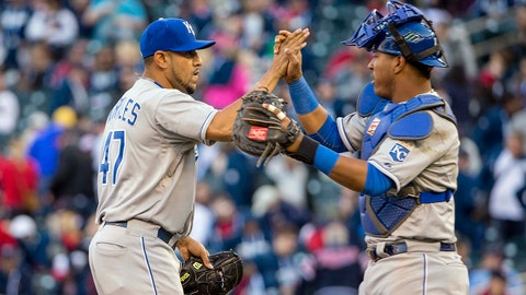 Apr 13, 2015; Minneapolis, MN, USA; Kansas City Royals relief pitcher Franklin Morales (47) celebrates with catcher Salvador Perez (13) after beating the Minnesota Twins at Target Field. The Royals won 12-3. Mandatory Credit: Jesse Johnson-USA TODAY Sports