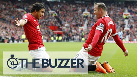 Manchester United's Wayne Rooney (R) celebrates with his teammate Rafael Da Silva after scoring a goal against West Ham United during their English Premier League soccer match at Old Trafford in Manchester, northern England September 27, 2014.   REUTERS/Darren Staples