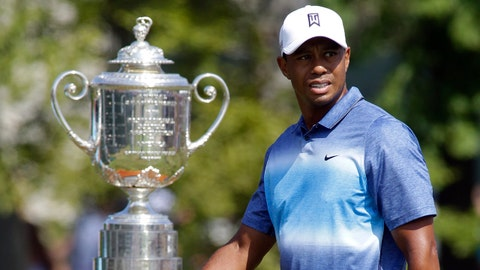 Aug 13, 2015; Sheboygan, WI, USA; Tiger Woods walks past the Wanamaker Trophy to the 1st tee during the first round of the 2015 PGA Championship golf tournament at Whistling Straits. Mandatory Credit: Gary C. Klein-Sheboygan Press Media via USA TODAY Sports