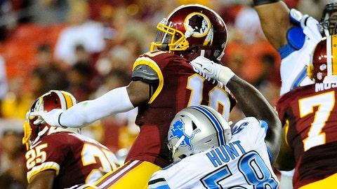 Aug 20, 2015; Landover, MD, USA; Detroit Lions defensive end Phillip Hunt (58) pressures Washington Redskins quarterback Robert Griffin III (10) during the first half at FedEx Field. Mandatory Credit: Brad Mills-USA TODAY Sports