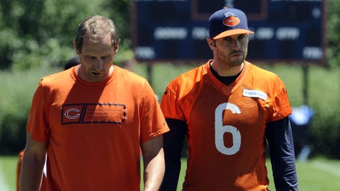FILE - In this June 16, 2015, file photo, Chicago Bears quarterback Jay Cutler, right, and offensive coordinator Adam Gase  walk together after NFL football minicamp  in Lake Forest, Ill. Gase is quarterback Cutler's fifth coordinator with the Bears and so far the pairing seems to be off on the right foot. (AP Photo/Matt Marton, File)