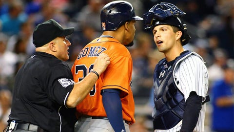 Aug 25, 2015; Bronx, NY, USA; Houston Astros center fielder Carlos Gomez (30) is restrained by home plate umpire Eric Cooper as Gomez and New York Yankees catcher John Ryan Murphy (66) go face to face after Gomez flew out in the sixth inning at Yankee Stadium. Mandatory Credit: Andy Marlin-USA TODAY Sports