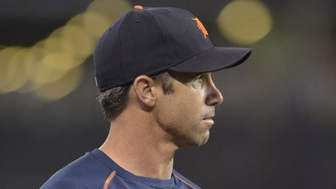 Sep 2, 2015; Kansas City, MO, USA; Detroit Tigers manager Brad Ausmus (7) walks to the dugout after a visit to the mound in the fourth inning against the Kansas City Royals at Kauffman Stadium. The Royals won 12-1. Mandatory Credit: Denny Medley-USA TODAY Sports