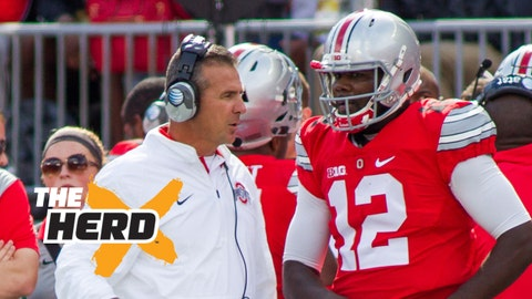 Sep 12, 2015; Columbus, OH, USA; Ohio State Buckeyes head coach Urban Meyer and quarterback Cardale Jones (12) talk on the sideline during the game against the Hawaii Warriors at Ohio Stadium. The Ohio State Buckeyes beat the Hawaii Warriors by the score of 38-0. Mandatory Credit: Trevor Ruszkowski-USA TODAY Sports