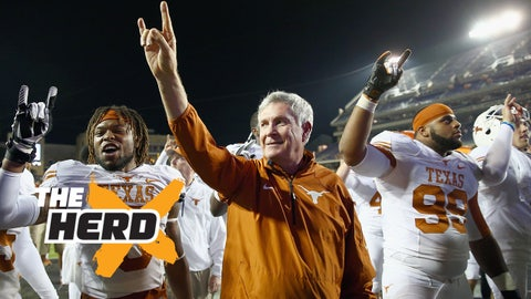 FORT WORTH, TX - OCTOBER 26:  Head coach Mack Brown of the Texas Longhorns celebrates with Desmond Jackson #99 of the Texas Longhorns and Josh Turner #5 of the Texas Longhorns after the Longhorns beat the TCU Horned Frogs 30-7 at Amon G. Carter Stadium on October 26, 2013 in Fort Worth, Texas.  (Photo by Tom Pennington/Getty Images)