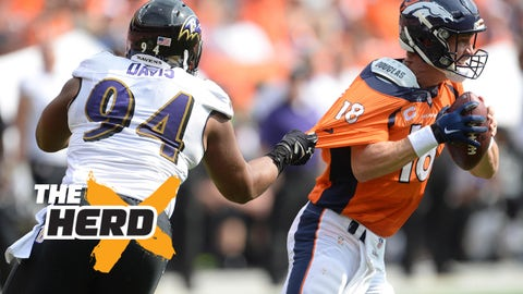 Sep 13, 2015; Denver, CO, USA; Baltimore Ravens defensive tackle Carl Davis (94) grabs onto Denver Broncos quarterback Peyton Manning (18) in the second quarter at Sports Authority Field at Mile High. Mandatory Credit: Ron Chenoy-USA TODAY Sports