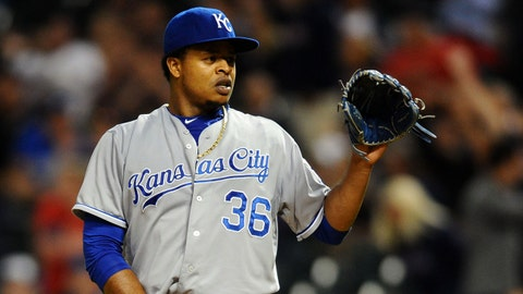 Sep 14, 2015; Cleveland, OH, USA; Kansas City Royals starting pitcher Edinson Volquez (36) waits for a new ball after giving up a home run to Cleveland Indians third baseman Giovanny Urshela (39) during the fourth inning at Progressive Field. Mandatory Credit: Ken Blaze-USA TODAY Sports