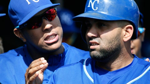 Kansas City Royals' Kendrys Morales, right, is congratulated by teammate Salvador Perez, left, after hitting a home run during the third inning of a baseball game against the Detroit Tigers at Comerica Park, Sunday, Sept. 20, 2015, in Detroit. Morales hit three home runs and set a team record with 15 total bases, and the Royals routed the Tigers 10-3 on Sunday. (AP Photo/Duane Burleson)