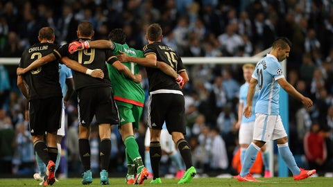 MANCHESTER, ENGLAND - SEPTEMBER 15:  A dejected Sergio Aguero of Manchester City as Juventus celebrate their 1-2 victory at the end of the UEFA Champions League Group D match between Manchester City FC and Juventus at the Etihad Stadium on September 15, 2015 in Manchester, United Kingdom.  (Photo by Matthew Ashton - AMA/Getty Images)
