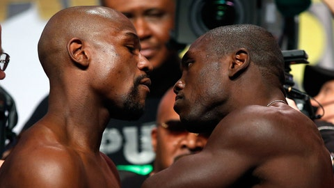 LAS VEGAS, NV - SEPTEMBER 11:  Boxers Floyd Mayweather Jr. (L) and Andre Berto face off during their official weigh-in at MGM Grand Garden Arena on September 11, 2015 in Las Vegas, Nevada. Mayweather will defend his WBC/WBA welterweight titles against Berto on September 12 at MGM Grand in Las Vegas.  (Photo by Ezra Shaw/Getty Images)