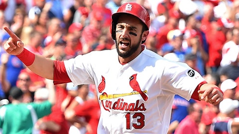 Sep 9, 2015; St. Louis, MO, USA; St. Louis Cardinals third baseman Matt Carpenter (13) reacts to scoring the go-ahead run in the eight inning against the Chicago Cubs at Busch Stadium. Mandatory Credit: Jasen Vinlove-USA TODAY Sports
