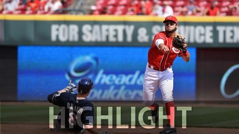 CINCINNATI, OH - SEPTEMBER 6:  Eugenio Suarez #7 of the Cincinnati Reds throws to first base after forcing out Ryan Braun #8 of the Milwaukee Brewers at second base in the sixth inning at Great American Ball Park on September 6, 2015 in Cincinnati, Ohio. Cincinnati defeated Milwaukee 6-3.  (Photo by Jamie Sabau/Getty Images)