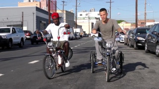 Nigel Sylvester and Levi Maestro ride through the City of Angels