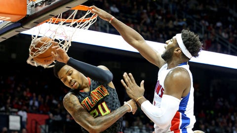 Oct 27, 2015; Atlanta, GA, USA; Detroit Pistons center Andre Drummond (0) dunks against Atlanta Hawks guard Kent Bazemore (24) in the first quarter of their game at Philips Arena. Mandatory Credit: Jason Getz-USA TODAY Sports