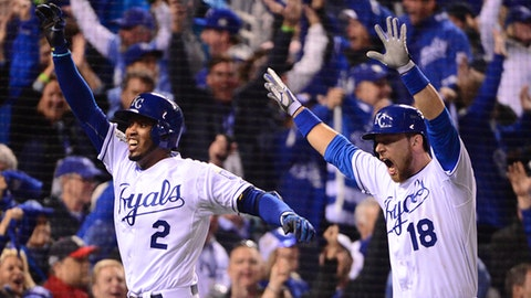 Oct 27, 2015; Kansas City, MO, USA; Kansas City Royals shortstop Alcides Escobar (2) celebrates with second baseman Ben Zobrist (18) after hitting an inside-the-park home run against the New York Mets in the first inning in game one of the 2015 World Series at Kauffman Stadium. Mandatory Credit: Jeff Curry-USA TODAY Sports