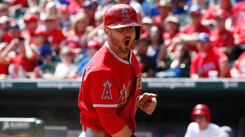 Oct 3, 2015; Arlington, TX, USA; Los Angeles Angels second baseman Johnny Giavotella (12) reacts after scoring on a wild pitch thrown by Texas Rangers starting pitcher Chi Chi Gonzalez (not shown) during the fifth inning of a baseball game at Globe Life Park in Arlington. Mandatory Credit: Jim Cowsert-USA TODAY Sports