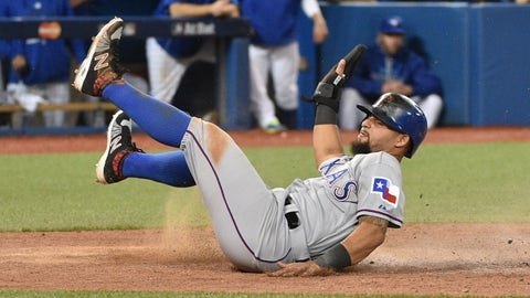 Oct 9, 2015; Toronto, Ontario, CAN; Texas Rangers second baseman Rougned Odor scores a run against the Toronto Blue Jays in the 14th inning in game two of the ALDS at Rogers Centre. Mandatory Credit: Nick Turchiaro-USA TODAY Sports
