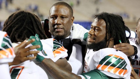 Oct 31, 2015; Durham, NC, USA; Miami Hurricanes interim head coach Larry Scott celebrates with his players including wide receiver Malcolm Lewis (9) after beating the Duke Blue Devils 30-27 at Wallace Wade Stadium. Mandatory Credit: Mark Dolejs-USA TODAY Sports