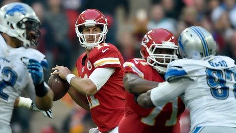 Nov 01, 2015; London, United Kingdom; Kansas City Chiefs quarterback Alex Smith (11) looks down field against the Detroit Lions at Wembley Stadium. Mandatory Credit: Steve Flynn-USA TODAY Sports