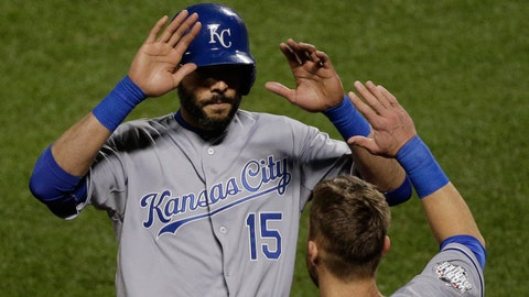 Kansas City Royals right fielder Alex Rios (15) is congratulated by Kansas City Royals' Alex Gordon after scoring on a passed ball during the second inning of Game 3 of the Major League Baseball World Series against the New York Mets Friday, Oct. 30, 2015, in New York. (AP Photo/Julie Jacobson)
