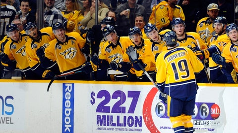 Dec 21, 2015; Nashville, TN, USA; Nashville Predators center Calle Jarnkrok (19) is congratulated by teammates after a goal during the third period against the Montreal Canadiens at Bridgestone Arena. Mandatory Credit: Christopher Hanewinckel-USA TODAY Sports