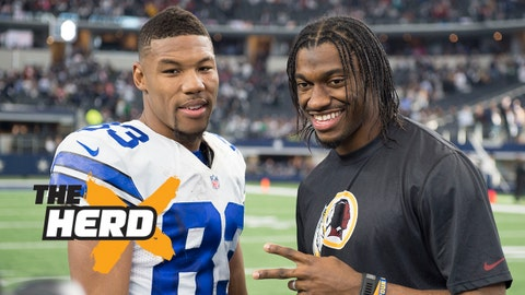 Jan 3, 2016; Arlington, TX, USA; Dallas Cowboys wide receiver Terrance Williams (83) poses for a photo with Washington Redskins quarterback Robert Griffin III (10) after the game at AT&T Stadium. The Redskins defeat the Cowboys 34-23. Mandatory Credit: Jerome Miron-USA TODAY Sports