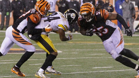 Cincinnati Bengals' Vontaze Burfict (55) runs into Pittsburgh Steelers' Antonio Brown (84) during the second half of an NFL wild-card playoff football game Sunday, Jan. 10, 2016, in Cincinnati. Pittsburgh won 18-16. Burfict was called for a penalty on the play. (AP Photo/John Minchillo)