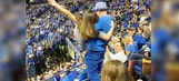 Watch a dancing Kentucky hoops fan crash down steps after scooping up a young woman