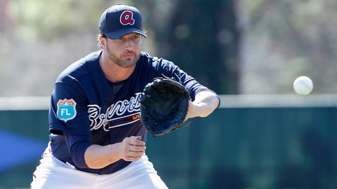 Feb 22, 2016; Lake Buena Vista, FL, USA; Atlanta Braves relief pitcher Jason Grilli (39) fields the ball during spring training workouts at ESPN's Wide World of Sports. Mandatory Credit: Reinhold Matay-USA TODAY Sports