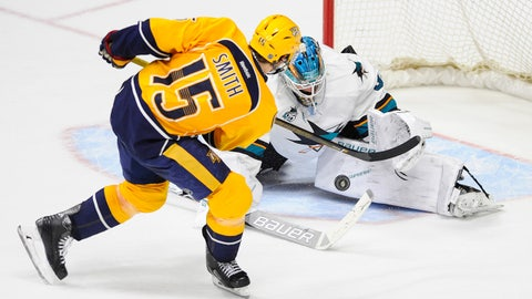 Apr 2, 2016; Nashville, TN, USA; San Jose Sharks goalie James Reimer (34) makes a save on a shootout attempt by Nashville Predators right winger Craig Smith (15) at Bridgestone Arena. The Sharks won 3-2 in a shootout. Mandatory Credit: Christopher Hanewinckel-USA TODAY Sports