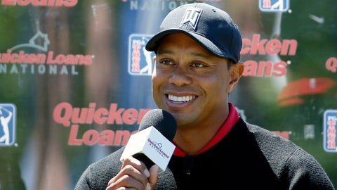 Tiger Woods smiles while speaking during a Quicken Loans National golf tournament media availability on the 10th tee at Congressional Country Club, Monday, May 16, 2016 in Bethesda, Md. (AP Photo/Alex Brandon)