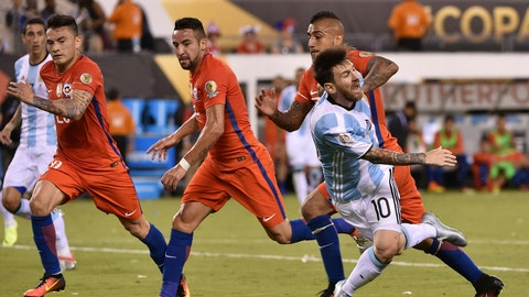 Argentina's Lionel Messi (front-R) falls marked by Chilean players during the Copa America Centenario final in East Rutherford, New Jersey, United States, on June 26, 2016.  / AFP / NELSON ALMEIDA        (Photo credit should read NELSON ALMEIDA/AFP/Getty Images)