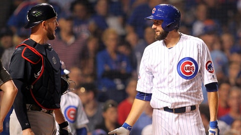 Jul 7, 2016; Chicago, IL, USA; Chicago Cubs starting pitcher Jason Hammel (39) talks to Atlanta Braves catcher Tyler Flowers (25)after he was hit by a pitch during the fifth inning at Wrigley Field. Mandatory Credit: Caylor Arnold-USA TODAY Sports