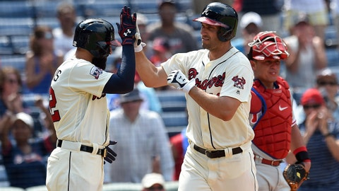 Jul 31, 2016; Atlanta, GA, USA; Atlanta Braves right fielder Nick Markakis (22) (left) high fives left fielder Jeff Francoeur (18) after Francoeur hit a home run against the Philadelphia Phillies during the seventh inning at Turner Field. Mandatory Credit: Dale Zanine-USA TODAY Sports