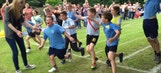 These students help a classmate with Down Syndrome win a race
