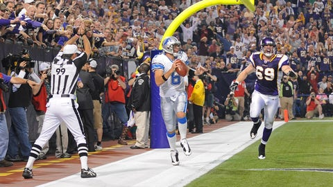 Dan Orlovsky runs out of the end zone for safety
