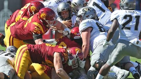 Trojans swarm tackle