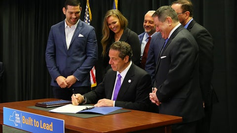 April 14: Rousey appears in New York as Governor Andrew Cuomo signs a bill to legalize MMA in the state