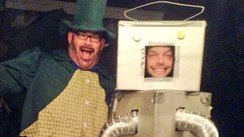 Albert as a leprechaun (featuring Finn Balor as a robot)